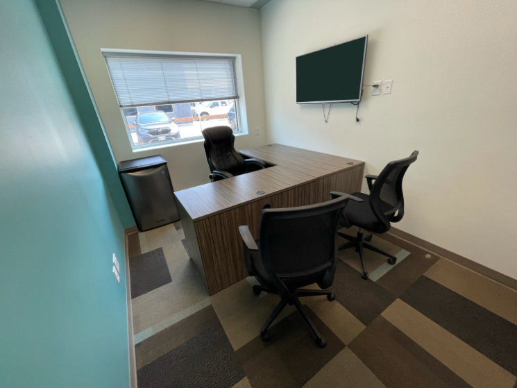 Window, Mini-Fridge, Desk and TV View of Office 15 in the EYE for Business Center