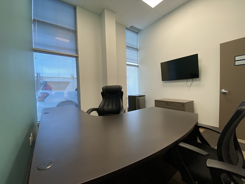 Window, Desk and TV View of Office 21 in the EYE For Business Center